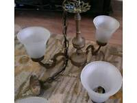 pair of antique light fittings with glass shades