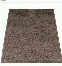 Small brown rug