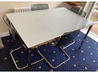White glass top dining table and 4 chairs