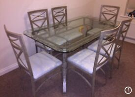Steel glass dining table with 6 chairs