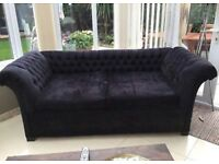 Black sofa and matching loveseat