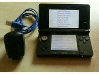 3DS console black with a charger