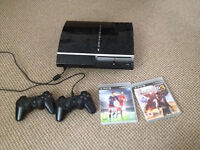 PS3, two wireless controllers and two games