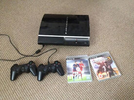 Playstation 3 with two controllers and two games