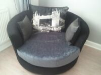 Black and grey rotating cuddle chair