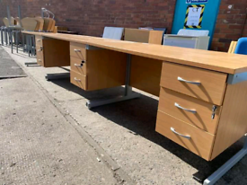Office desks with drawers each