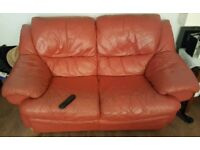 Free leather suite. 2 2 seater sofas and a recliner chair.