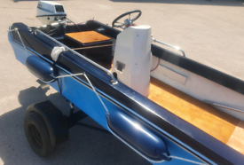 Dory boat with 9.9hp engine and road trailer