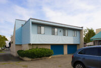 Free-standing, open plan office building with onsite parking.