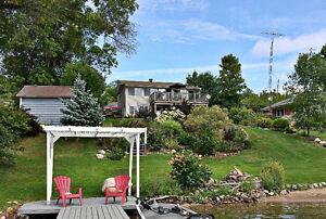 Lake Lauzon - Desireable Lakefront Cottage with Private Beach