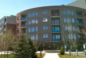 Available Now! Sky Waterfront Condominiums, 1 bed+den w/parking