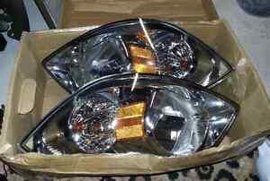 2 Phare Chevrolet Cobalt, SS, LT,etc. Pontiac G5 ( prix nego )