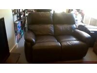 x2 2 seater dark brown leather recliner sofas and pouffee