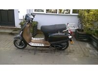 Goodlooking Retro Style 50cc Scooter. Only 58 miles on the clock. Real Bargain at £695.
