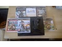 Playstation 3 super slim(500gb)+ 7 games