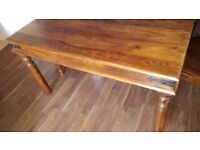 dark wood table and 4 chairs