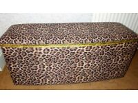 Vintage retro storage solution, a gorgeous 1960s ottoman recovered in funky leopard print fabric.