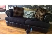 two 3 seater chesterfield sofas leather and material black and gold grey cushions