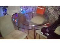 Round glass table and four chairs