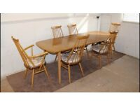 Ercol Grand Windsor extending dining table and six dining chairs c/w cushions