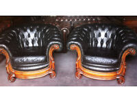 Pair of black leather Chesterfield armchairs...