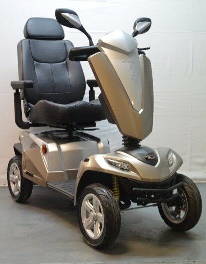 Mobility scooter 8mph. 2014. up to 35 miles. Great condition. Gold and grey.
