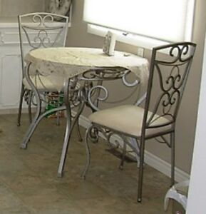 Beautiful Round Glass kitchen table and two chairs