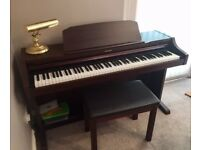 TECHNICS XS-PX332 DIGITAL PIANO AND STOOL IN MAHOGANY.