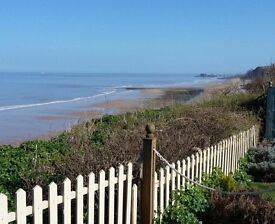 2 bed-Holiday bungalow hire- Cromer -Norfolk - great sea views-with own garden