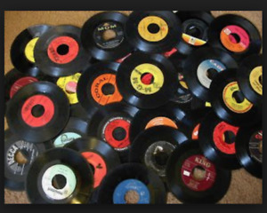 over one hundred 7 inch vinyl records from 60's and 70's.