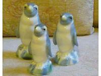 Set of three pottery penquins