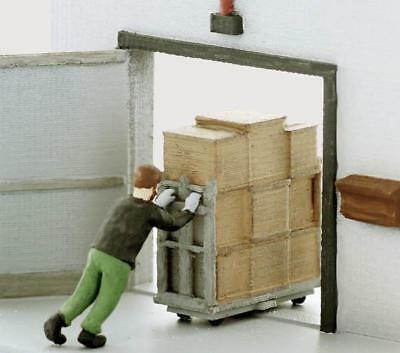 WAREHOUSE or Dock Worker busy pushing in a heavy loaded cart, S scale Finished