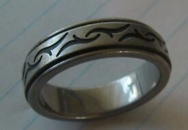TITANIUM RING FROM H.SAMUELS SIZE X VERY GOOD CONDITION HARDLY EVER WORN