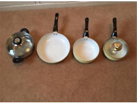 Set of four pots and pans
