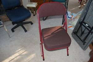 "Folding chair with 4"" padded seat for long sitting comfort."