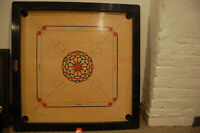 Carrom Board with man made ivory striker, coins, and powder