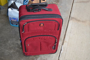 Very nice Swiss Gear Mid size suitcase $35 in Riverbend