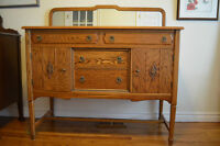 An exquisite solid oak sideboard complete with mirror