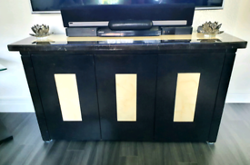 Beautiful marble topped sideboard finished with black and cream detail