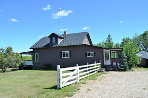 WELCOME HOME TO THIS BEAUTIFUL ACREAGE