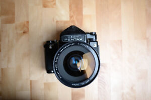 Pentax 67 camera with metered prism kit with 2 lenses.