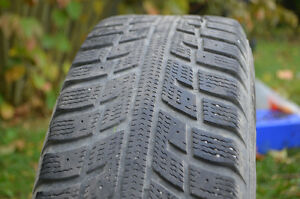 Four Winter Tires on rims in EUC Peterborough Peterborough Area image 1