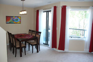 2 Bedroom Condo, two stories with balcony, close to U of M
