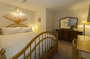 Two Bedroom + Den Furnished Garden Suite Available