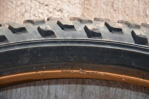 """Pair of used 24"""" mountain bike tires with tubes."""