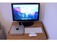 Apple Mac Mini. Mid 2010 model. 8gb ram upgrade. Genuine Apple Keyboard, Magic Mouse and monitor.