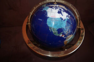 Each country on Globe cut from natural stones,moved to condo