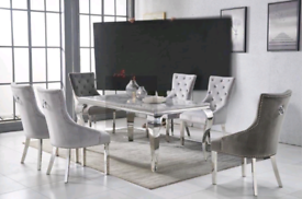 Brand New 160cm Glass topped table with 6 plush Knockerback chairs