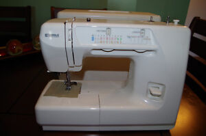 Kenmore sewing machine, almost new, moved to condo no room and