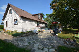 ON 1.28 acres overlooking Scugog River! 101 Maple Lane Drive